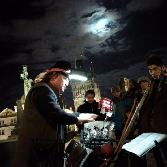 Charles Bridge Preformer under winter's full moon